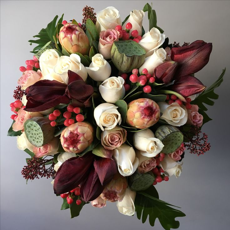 Bouquet of amaryllis, proteas, roses, nelumbo and hypericums #hanaflowershop