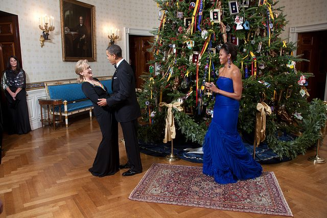 President Barack Obama and First Lady Michelle Obama greet Kennedy Center honoree Meryl Streep in the Blue Room of the White House, Dec. 4, 2011. (Official White House Photo by Lawrence Jackson
