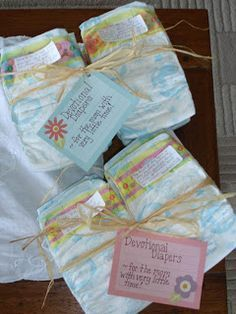 Here is a simple and quick idea for a baby shower gift that new moms love. Devotional Diapers….since you know that new mamas barely have time to brush their teeth, let alone finding time to get in the Word! This is all you need: newborn diapers mailing labels ribbon or raffia a card that says …