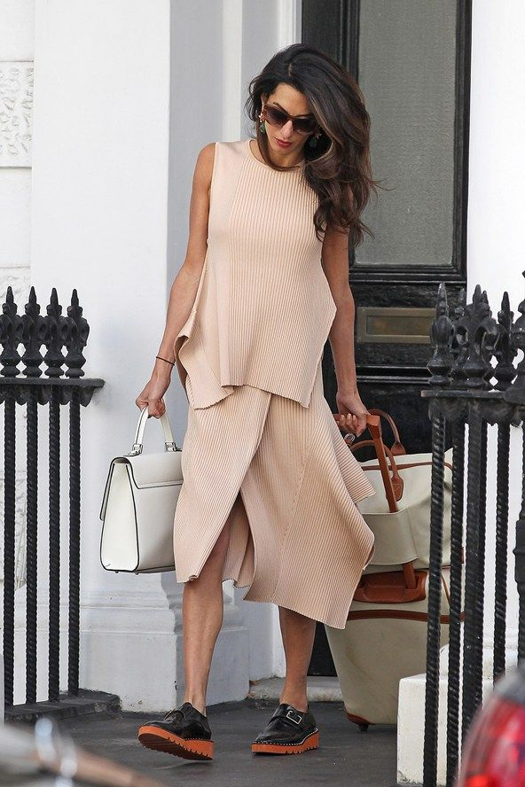 August 19 Amal Alamuddin opts for masculine flats, instead of her usual feminine high-heel style of footwear while out and about in London.