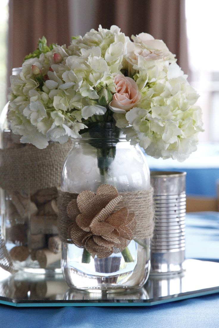 Vintage mason jar centerpiece with hydrangea spray roses