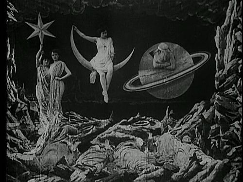 stars, crescent moon (and a cranky old saturn), still from georges méliès' film trip to the moon, 1902