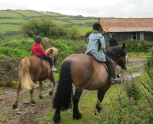 Horse riding available at Doone Valley Holidays campsite in Devon.  (Not a kids pony ride, but riding over real countryside)