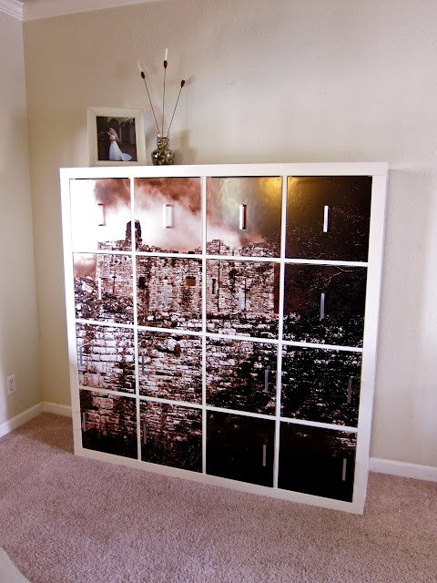 Absolutely love this Ikea hack, particularly the top shelves - they're just panels with a handle and four magnet mounts in the corners. (I like how this idea covers the open storage without greatly reducing the usable storage space.) The large-scale photo mosaic really sells it though.
