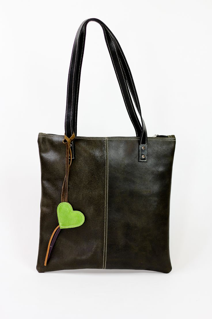"""PRODUCT INFO      This vintage style genuine leather handbag features:          * Zipper Closure         * Inside zipper compartment         * Handmade         * Dimensions Length 13.78"""" Width .4"""" Height: 13.78""""         * Double Shoulder Strap (11"""" to midpoint)      Carry everyday items; Tablet, cell phone, keys, make up among others."""