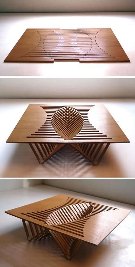 A unique way of folding up a coffee table into a flat pack square wood piece that can be stored on the side somewhere to save space.