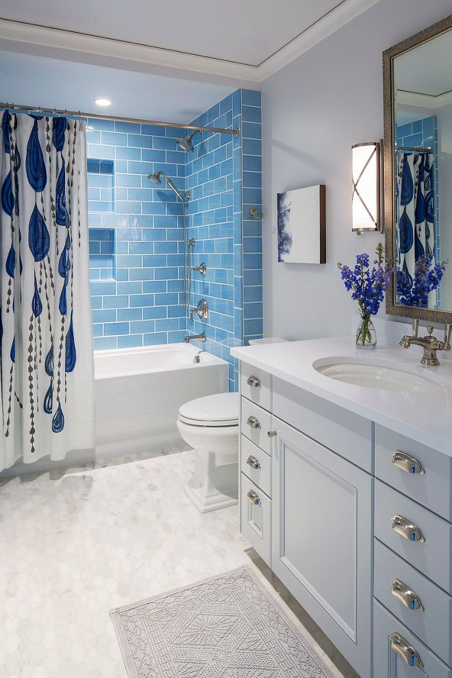 blue subway tile bathroom with blue subway tile wall and hex marble floor tile