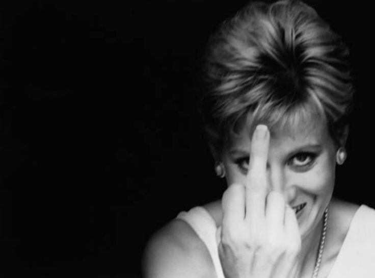 A rare shot of the lovely Princess Diana.  She had a wonderful, spunky sense of humor. <3<3<3