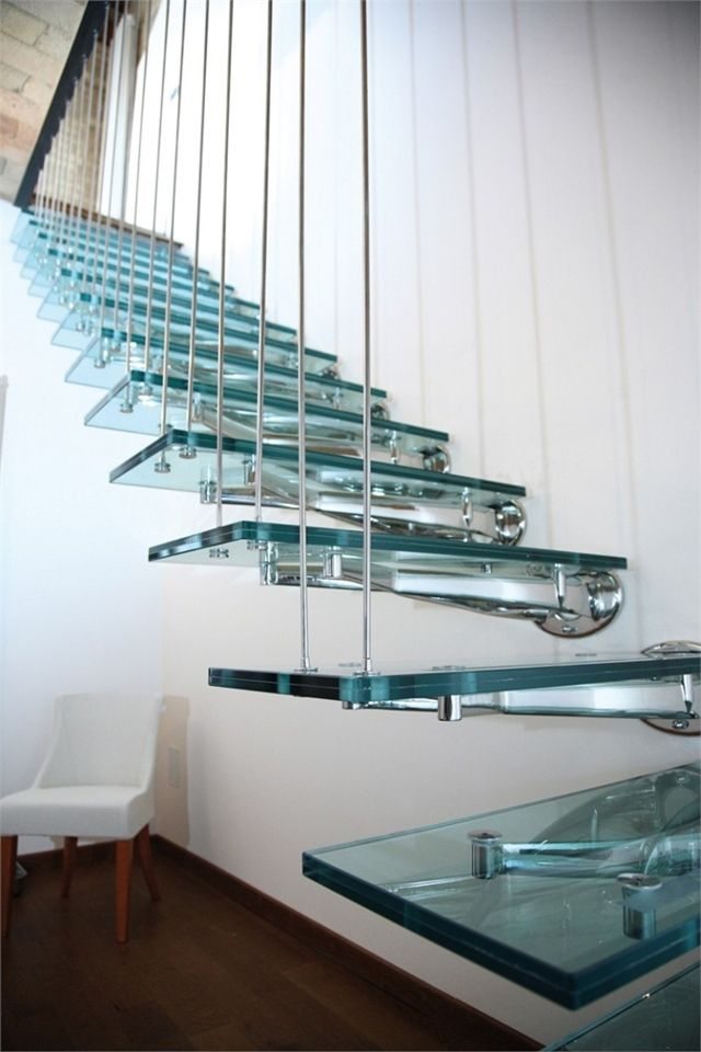 A transparent glass staircase that is sleek, modern and edgy.