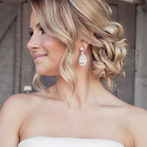 If you're comfortable having some of your hair falling loose and soft, this one's a beauty. #refinery29 http://www.refinery29.com/bridal-guide/26#slide-17