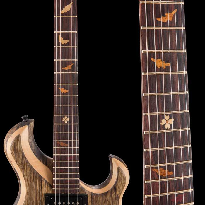 Fretboard inlay of fall colored leaves, dogwood flower