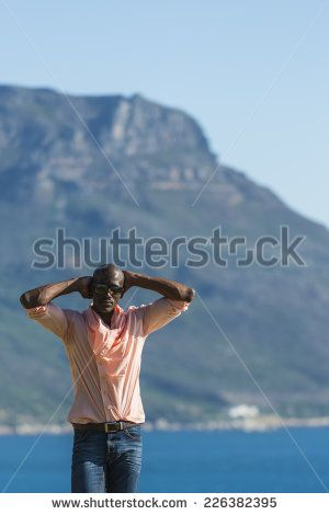 http://www.shutterstock.com/pic-226382395/stock-photo-african-black-man-standing-on-a-high-rock-overlooking-cape-town-as-he-points-and-scouts-the-blue.html?src=WuffEuvvGWj02MQSGcnIHQ-1-14 African Black Man, Standing On A High Rock Overlooking Cape Town As He Points And Scouts The Blue Sky, Ocean And Mountains On A Sunny Summers Day Stock Photo 226382395 : Shutterstock