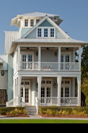 HOME DECOR – COASTAL STYLE – a victorian style coastal home with a second story porch.