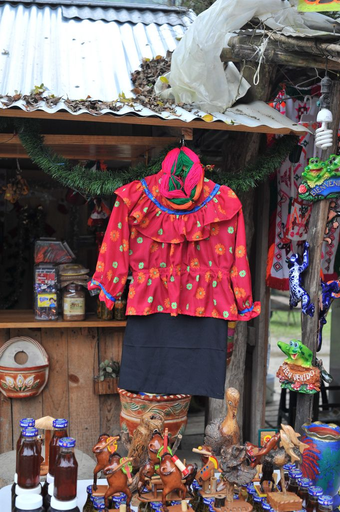 huastec tenek woman's costume | by Teyacapan. on sale in la escalera, san luis potosi, mexico is a woman's costume. this consists of a black wrap skirt, long sleeve blouse and petob, or yarn circles that are wound into a woman's hair.