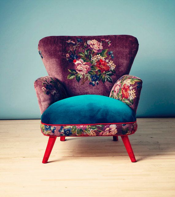 Velvet floral, purple and blue chair with red legs. Multicolored, beautiful.