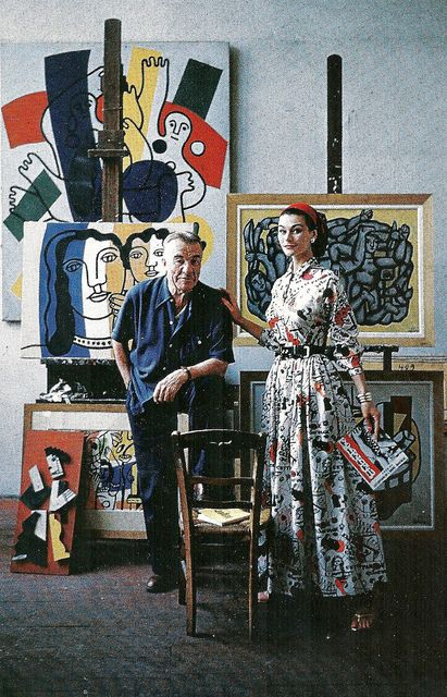 Anne Gunning in dress by Claire McCardell stands with artist Fernand Lèger in his studio, photo by Mark Shaw, 1955