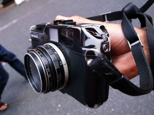 """Shinjuku Bessa R with Voigtlander 35mm f2.5 Pancake lens This picture is for anyone who thinks that the film camera scene in Tokyo is comprised of """"poseurs"""". Judging by the amount of wear on this Bessa it's also a fairly good illustration in proving..."""