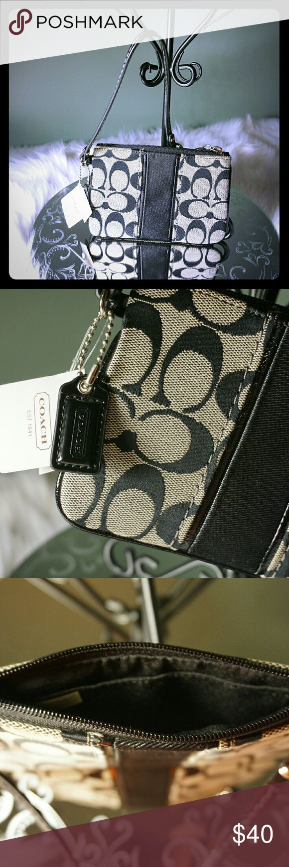 Coach Wristlet NWT Beautiful brand new signature vertical Stripe Coach Wristlet 6.5 Wide by 4.5 Inches High. Perfect for I'D, Credit Cards, Cash or to keep valuables safe inside a larger bag. Coach Wristlet MSRP $58.00. Price section removed from tag as was previous never used gift. Coach Bags Clutches & Wristlets