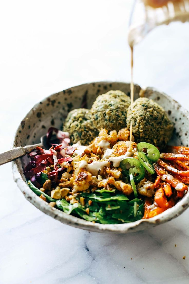 Eat well AND keep your glow all through winter! Easy homemade falafel, roasted veggies, and flavorful sauce all in one big bowl! vegetarian / vegan / gluten free recipe. | pinchofyum.com