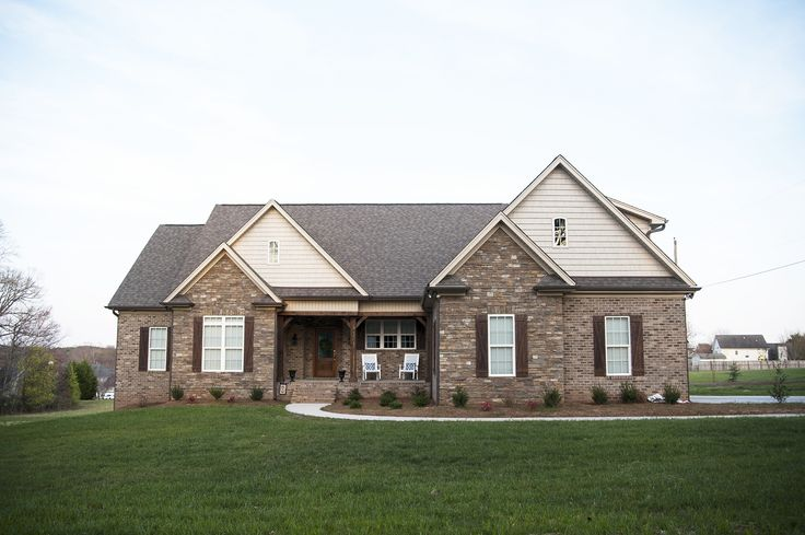 Siding and stone detailing add craftsman charm to this for Craftsman homes with stone