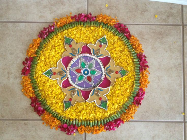 Rangoli on floor with flower petals