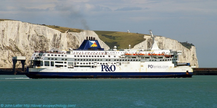 MS Pride of Calais and the White Cliffs of Dover, Dover Harbour, Kent, England, UK. Built by Schichau Unterweser AG in 1987 for Townsend Thoresen, then P and O Ferries. Now Ostend Spirit for Transeuropa Ferries. Ex-P and OSL Calais (P and O SL, Stena Line), PO Calais. Call Sign GJLY, IMO 8517748, MMSI 232001710. Departing Eastern Docks on cross-English Channel route. View: Prince of Wales Pier. Port of Dover Ferry, Ship, Travel, Tourism and Vacation. See…