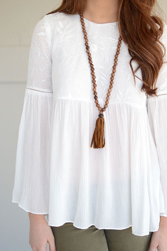 We. Are. Obsessed. This boho floral top by Do + Be in a gorgeous ivory color has us swooning! What's not to love about this piece? Featuring long bell sleeves and beautiful floral embroidery on the bu