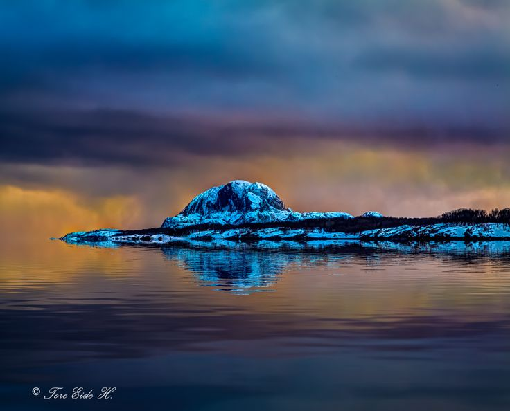 Colors of a winter sunset - Photo from the north of Norway with the mountain Torghatten in the horizon.