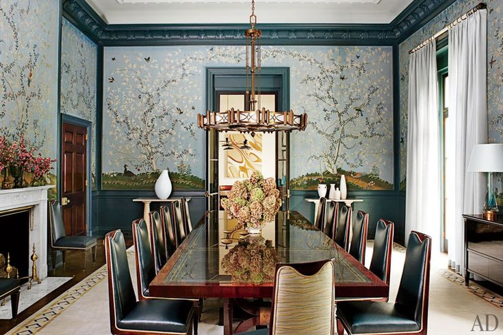 The dining room of a revitalized 1930s mansion in Old Westbury, New York,  retains its original Gracie scenic wall covering, which was carefully removed before the remodel and reinstalled.