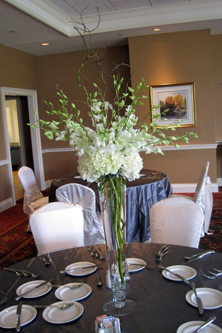Tall White Centerpiece Of Hydrangeas Willow And Orchids