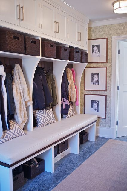 Mudroom area - love the three framed photos!