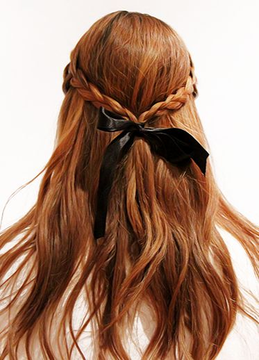 Ribbon braid bend together whit black bow.