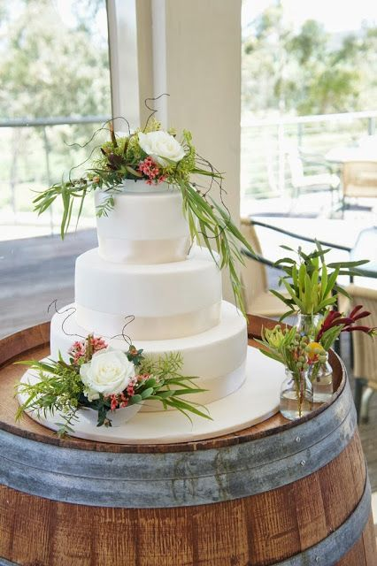 Australian native flowers cake decoration | Love the idea of a plain white cake with native greenery!