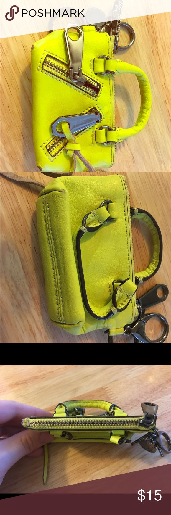 """Rebecca Minkoff """"Mini Moto"""" Coinpurse Good used condition. Neon yellow. Holds about 3 cards and ID plus coins. Some scuffing on corners (shown in pics). Rebecca Minkoff Bags"""