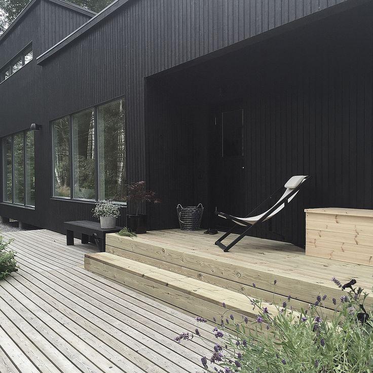 Summer house painted black. Photo by Minna Jones.