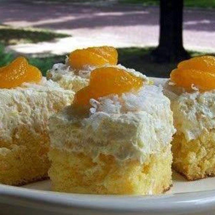 Hawaiin Dream Cake. Pinapple, Orange, Coconut-y flavors. Grandma used to make this all the time.