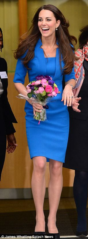 The Duchess was greeted by raucous applause by the school¿s 1,000 pupils when she arrived in the school hall