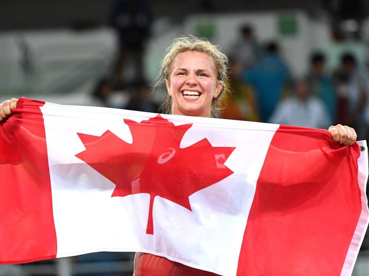 Canada's Erica Wiebe, of Ottawa, celebrates after winning the gold medal in the women's 75-kilogram freestyle wrestling against Kazakhstan's Guzel Manyurova at the 2016 Summer Olympics in Rio de Janeiro, Brazil, Thursday, August 18, 2016. THE CANADIAN PRESS/Ryan Remiorz
