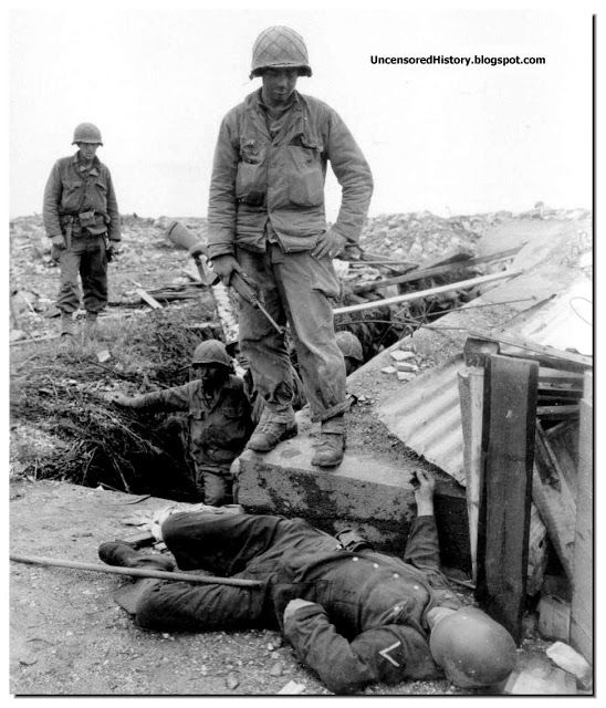 Captured bunker with a dead German