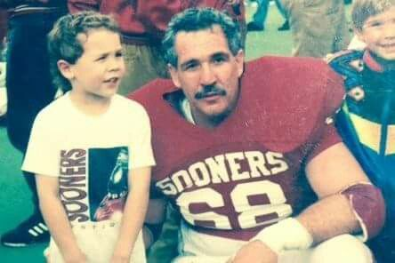 Very young Sam Bradford with his father Kent...he was a lineman...how cool!!!!!