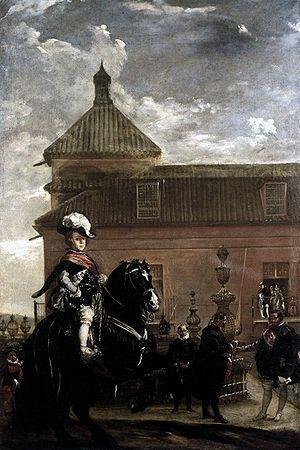 Velázquez (1636–1637) se representa una clase de equitación del Príncipe Baltasar Carlos, que debe exhibir con ello su identificación con el modo de vida nobiliario.  Asomados a un balcón del Alcázar de Madrid, capital política de la Monarquía Hispánica, los reyes Felipe IV e Isabel de Borbón.