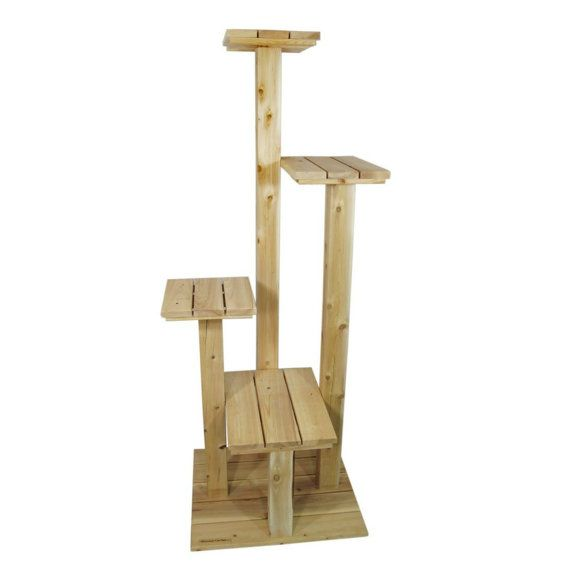 This indoor/outdoor cat tree stands 7 feet tall and is made with solid cedar posts and cypress base and platforms.  Great for placing on a