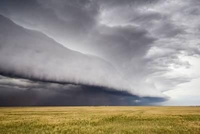 A Supercell Thunderstorm Produces a Spectacular Shelf Cloud over Cropland Photographic Print by Jim Reed at Art.com