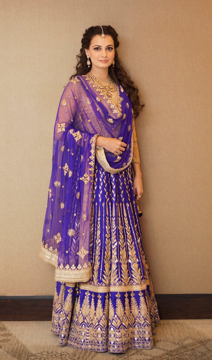 Dia Mirza dons a bridal purple lehenga for her Mehndi-Sangeet function.