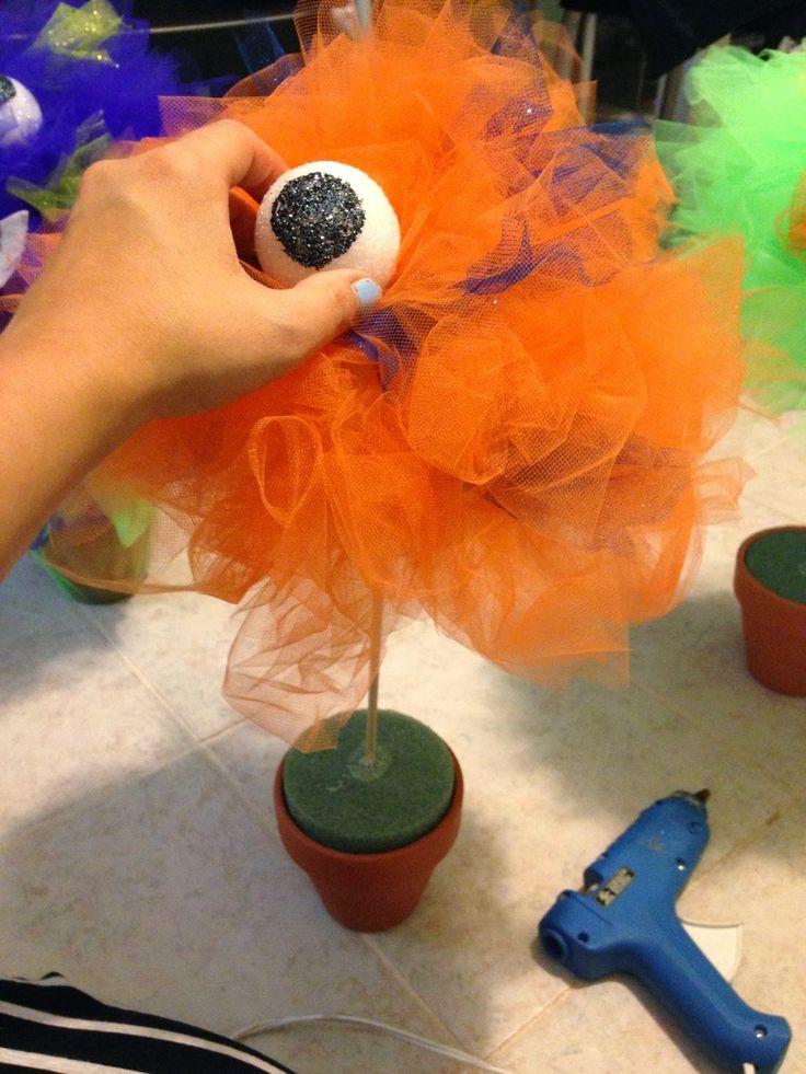 styrofoam balls and a little glitter glue make for easy monster eyes