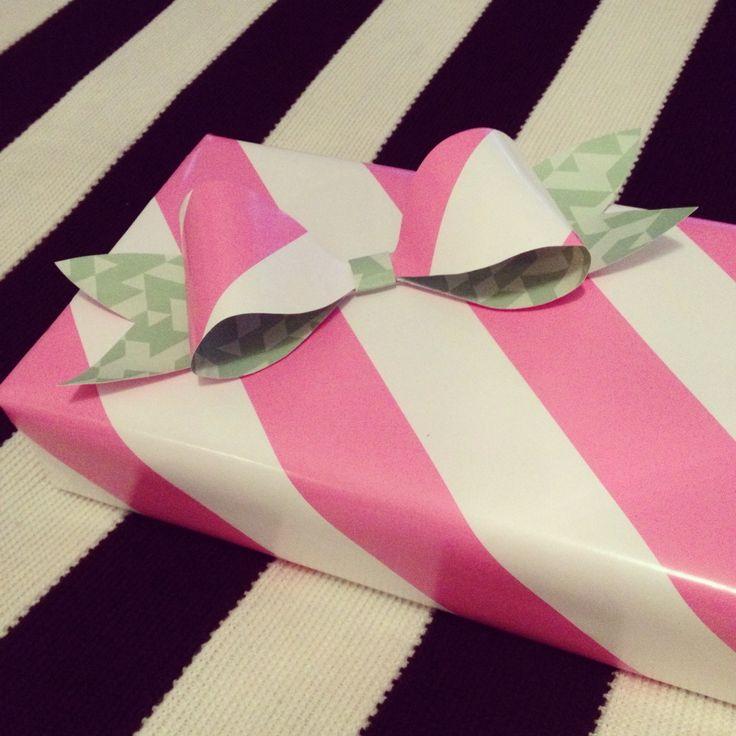 Pink giftwrapping with a paper bow