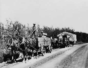 """In 1930's, drought hit the prairies, created a dustbowl and stopped growing of wheat, Canada's most profitable export. 250,000  farmers abandoned their farms during this time, because they could not afford to keep operating them.  Pictured here, settlers leaving farms in the """"dry belt"""" areas in southern Saskatchewan moving along No. 4 Highway north of Battleford. (National Archives of Canada, PA-044575"""