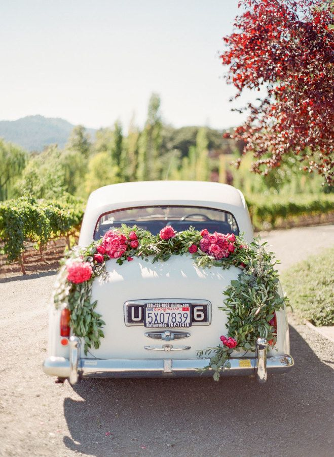 Elegant floral-draped getaway car: http://www.stylemepretty.com/2016/03/23/a-pink-purple-wedding-set-in-napa-valley/ | Photography: KT Merry - http://www.ktmerry.com/