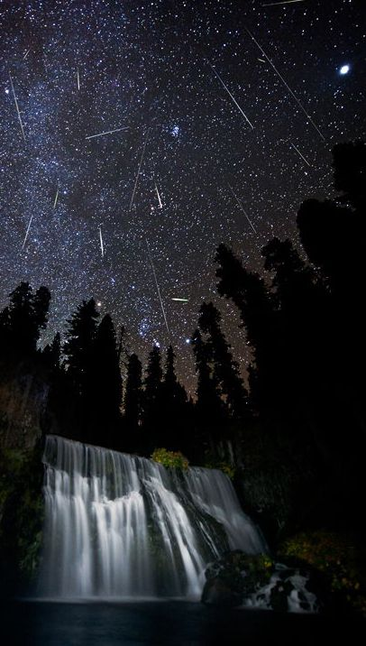Spectacular view of the Orionid meteor shower over Middle Falls outside the city of McCloud, Calif., near Mount Shasta showing many meteors streaking through the Milky Way galaxy over the lighted falls. (Image Credit:  Brad Goldpaint of Goldpaint Photography)