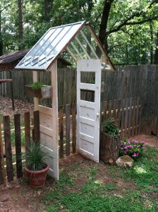 Up-cycled pallets, windows, and doors.